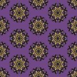 在紫色背景的金黄和黑装饰品样式 库存照片