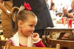 在红色传统服装打扮的女孩 免版税库存图片