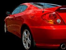 在红色体育运动的黑色汽车 免版税库存照片