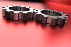 在红色光亮的背景的链轮 免版税库存图片