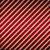 在红色和白色条纹的一张被弄皱的纸 免版税库存图片