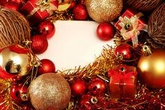 在红色和金子题材的圣诞节项目与白色框架为写词 免版税图库摄影