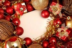 在红色和金子题材的圣诞节项目与白色框架为写词 库存图片