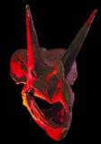 在红色和黑色的一块三角恐龙头骨 库存照片