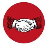 在红色圈子的握手板刻 库存图片