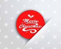 在红色圈子笔记口袋的圣诞快乐商标 免版税库存照片