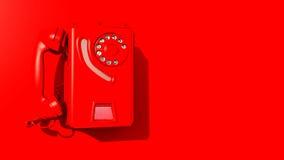 在红色墙壁上的红色墙壁电话 库存图片