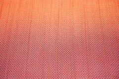 在红色席子的样式编织 免版税库存照片