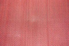 在红色席子的样式编织 库存图片