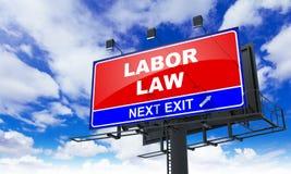 在红色广告牌的劳工法 免版税图库摄影