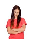 在红色打扮的沮丧的深色的女孩 库存照片