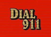 在红色救护车的拨号盘911 免版税图库摄影