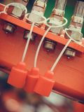 在红色机械的四个水力管子 免版税库存照片