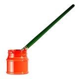 在红色油漆罐头的绿色油漆刷 免版税图库摄影