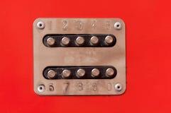 在红色的号码锁 免版税库存图片