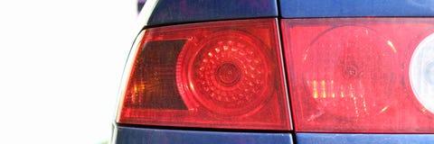 在红色的后方左汽车灯笼光学蓝色 免版税库存图片