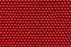 在红色的抽象小点背景 免版税库存照片