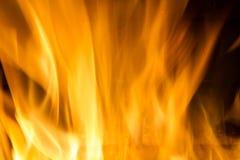 在红色的火焰黑叉子的背景橙黄和 免版税图库摄影