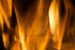 在红色的火焰黑叉子的背景橙黄和 免版税库存图片