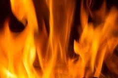 在红色的火焰黑叉子的背景橙黄和 库存照片