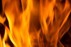 在红色的火焰黑叉子的背景橙黄和 免版税库存照片