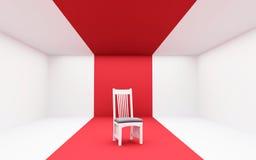 在红色的白色椅子 免版税图库摄影