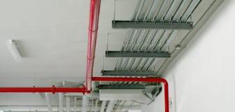 在红色的系统管子 库存图片