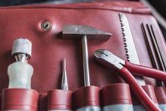 在红色皮革盒的工具 免版税库存图片