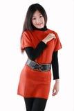在红色礼服的亚洲时装模特儿 免版税库存照片