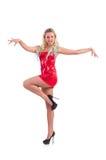在红色礼服的妇女跳舞 库存照片