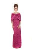 在红色礼服的美好的妇女时装模特儿 免版税库存图片