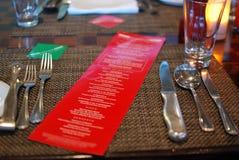 在红色纸的一份晚餐菜单 库存照片