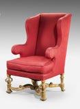 在红色老古董布置的大红色翼状靠背椅需要r 库存照片