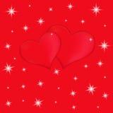 在红色背景的两红色心脏与星 免版税图库摄影