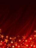 在红色背景的光亮的星形 库存照片