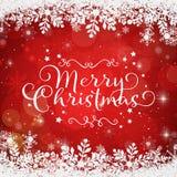 在红色背景的圣诞快乐在一个多雪的框架 免版税库存照片