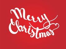 在红色背景的圣诞快乐字法 图库摄影