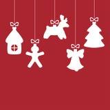 在红色背景的圣诞节装饰中看不中用的物品 库存图片