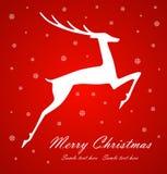 在红色背景的圣诞节鹿 库存图片