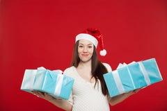 在红色背景的怀孕圣诞节 库存图片