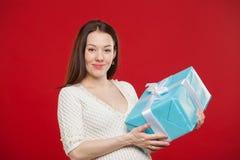 在红色背景的怀孕圣诞节 图库摄影