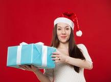 在红色背景的怀孕圣诞节 免版税库存照片