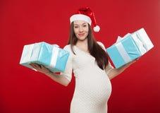 在红色背景的怀孕圣诞节 库存照片