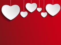 在红色背景的情人节心脏 免版税库存照片