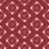 在红色背景的无缝的样式心脏瓦片 免版税库存图片