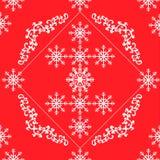 在红色背景的无缝的白色透雕细工花卉样式 图库摄影