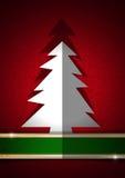 在红色背景的白色圣诞节树 库存图片