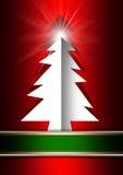 在红色背景的白色圣诞节树 免版税库存照片