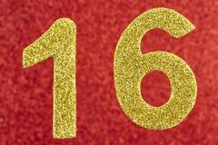 在红色背景的第十六金黄颜色 附注 免版税库存照片