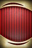 在红色背景的金子 图库摄影
